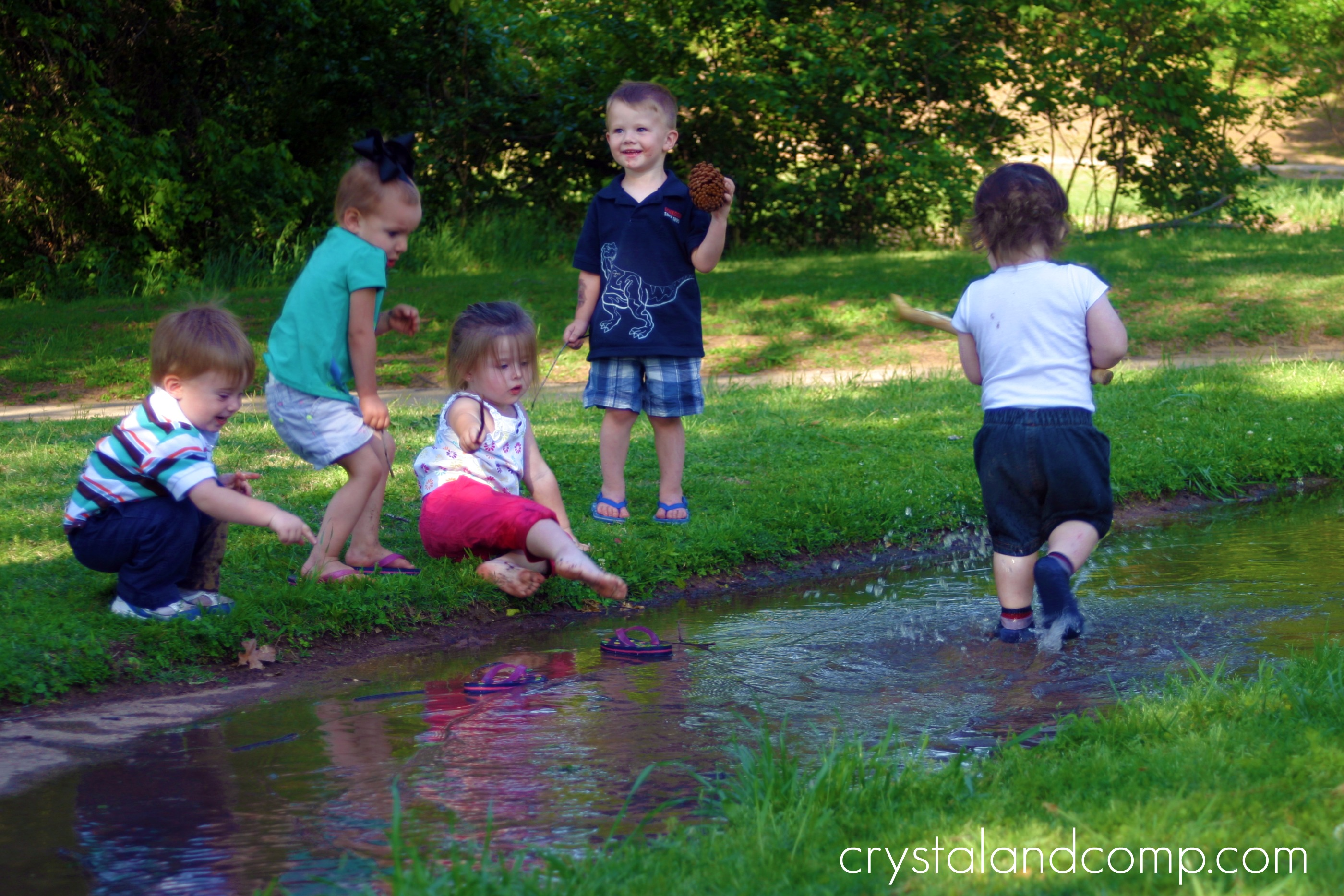 Kids Playing In Puddles